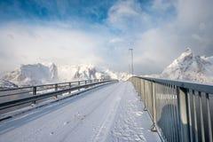 Bridge cross over arctic ocean with snowy mountain. At Hamnoy, Lofoten Islands, Norway royalty free stock images