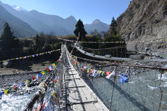 The bridge cross over the river with prayer flag row Royalty Free Stock Photo