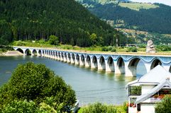 Bridge cross the river. Between mountains royalty free stock photos