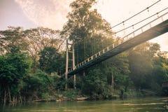 Bridge cross on river kwai in tropical rainforest. At Sai Yok Yai stock image