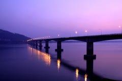 Bridge cross the river. With twilight stock image