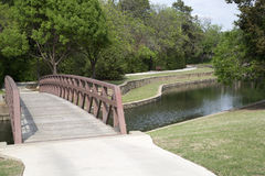 Bridge crosses  a creek in a park Stock Photography