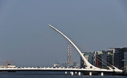 Bridge crosses the Liffey River in Dublin. Stock Image