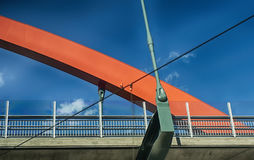 Bridge that crosses over a walk path and motorway Stock Image