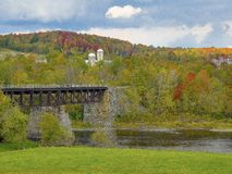 A bridge crossing the river. Beautiful autumn landscape that we have in Quebec, Canada. Photo taken during a trip to the Eastern Townships, the trees had taken royalty free stock photos