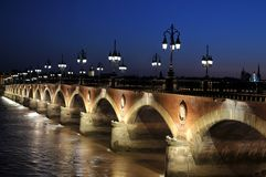 The stone bridge at night in Bordeaux, France royalty free stock photos