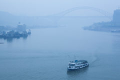 Bridge crossing the river, heavy fog and haze Stock Images