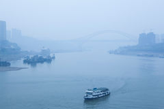 Bridge crossing the river, heavy fog and haze Royalty Free Stock Images