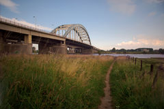 Bridge crossing river Lek Royalty Free Stock Photography