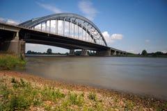 Bridge crossing river Lek Royalty Free Stock Images