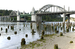 Bridge crossings, Florence OR. Bridge crossings and river with tree stumps, Florence OR Stock Image