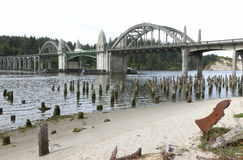 Bridge crossings, Florence OR. Bridge crossings and river with tree stumps, Florence OR Royalty Free Stock Photography