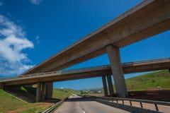 Bridge Crossings Highways. Two Bridges Cross Diagonally Blue Three Highways Royalty Free Stock Image