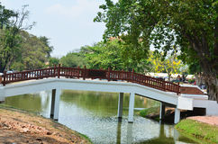 Bridge crossover canal in Ayutthaya Historical Park Thailand. As a UNESCO World Heritage City, Ayutthaya is mostly about exploring the ruin sites and temples Stock Photo