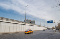 A bridge at the crossroad in beijing. In Beijing, a taxi drove positive in the direction of the bridge, this photo was taken in March 9, 2014 Stock Photo