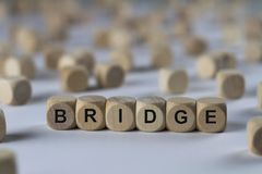 Bridge - cube with letters, sign with wooden cubes Stock Image