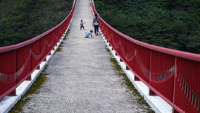 The bridge on the dam. It is the beautiful red bridge on the dam in Japan Stock Photography