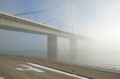Bridge on Danube river. Winter morning by Danube river with bridge in fog Stock Image