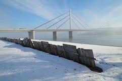 Bridge on Danube river. Winter morning by Danube river with bridge in fog Royalty Free Stock Photos