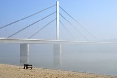 Bridge on Danube river. Winter day on Danube river with bridge in fog Royalty Free Stock Images