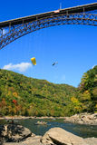 Bridge Day Base Jumpers New River Gorge Bridge. Two base jumpers float down after leaping from the New River Gorge Bridge during their world famous annual Bridge Stock Image