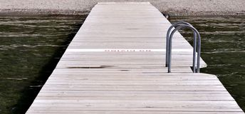 Wooden deck to the beach Stock Photography