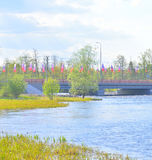 Bridge decorated with flags in Priozersk. Royalty Free Stock Image