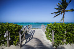 Bridge with a Desert Island in Background Stock Images