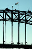 Bridge detail. Detail photo of harbour bridge in sydney, australian flag, people on top Stock Images