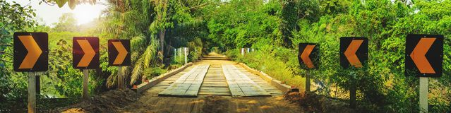 Bridge on a dirt road surrounded by the forest known as Estrada Stock Photo