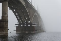 The bridge disappeared into the fog. A thick fog. Royalty Free Stock Image