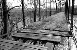Bridge of Discouraged Travel. Black and white low angle view of an old bridge that is oviously not safe to travel on anymore Royalty Free Stock Images