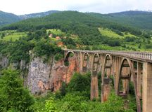 The bridge Djurdjevica Tara bridge is a concrete arch bridge over the Tara river in Northern Montenegro. stock photography