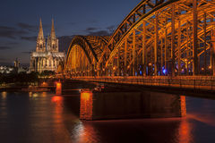 Bridge and the Dom of Cologne. At night. Cologne, Germany Stock Images