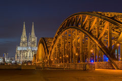 Bridge and the Dom of Cologne. At night. Cologne, Germany Stock Photos