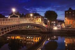 Bridge in Dublin. Night view of famous Ha'Penny Bridge in Dublin, Ireland Stock Photo