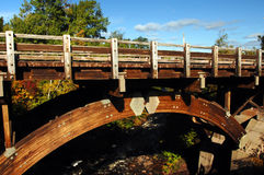 Bridge at Eagle River Falls. Historic bridge at Eagle River Falls is a landmark in Upper Peninsula, Michigan.  Wooden trusses arch across river Stock Photography