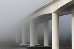 Bridge in the early morning mist Royalty Free Stock Images
