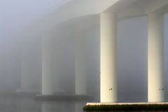 Bridge in the early morning mist Royalty Free Stock Photos