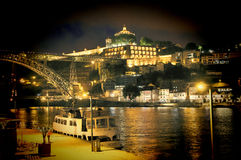 The bridge on edge of Oporto Ribeira in the evening, Portugal Royalty Free Stock Photo