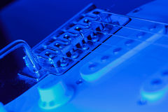Bridge of an electric guitar with blue light Royalty Free Stock Photo
