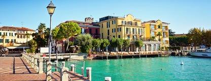 Bridge embankment yacht pier Lake Garda restaurants hotels luxur. Y resort Sirmione Italy stock image