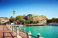Bridge embankment yacht pier Lake Garda restaurants hotels luxury resort Sirmione Italy royalty free stock photos