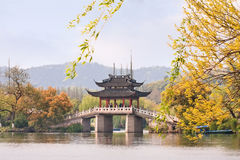 Bridge at enchanting West Lake in autumn colors, Hangzhou, China Royalty Free Stock Images