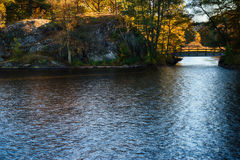 Bridge at fall. A bridge over a small river at fall stock photography