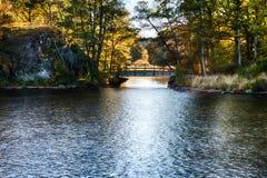 Bridge at fall. A bridge over a small river at fall royalty free stock image