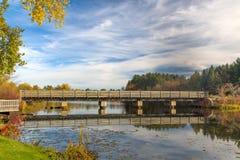 Bridge featuring Autumn Vibrant Colors on Apple River Stock Photo