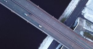 Bridge filmed from above. On frosty winter day. Camera slowly zooms out stock video footage