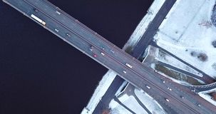 Bridge filmed from above. On frosty winter day. Camera slowly zooms out stock footage