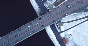 Bridge filmed from above. On winter day. Camera slowly zooms in stock video